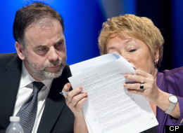 Quebec Premier Pauline Marois and Education Minister Pierre Duchesne read a document during the education summit Monday, February 25, 2013 in Montreal. THE CANADIAN PRESS/Paul Chiasson