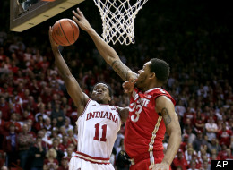 Indiana's Yogi Ferrell (11) has his shot blocked by Ohio State's Amir Williams during the second half of an NCAA college basketball game, Tuesday, March 5, 2013, in Bloomington, Ind. Ohio State won 67-58. (AP Photo/Darron Cummings)