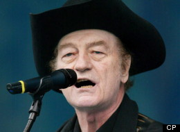 Stompin' Tom Connors performs at Live from Rideau Hall, a concert held at Rideau Hall in Ottawa Sunday, June 16, 2002. THE CANADIAN PRESS/Jonathan Hayward
