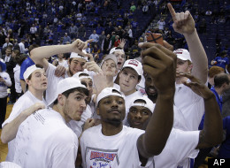 Doug McDermott, center, and several players from Creighton pose for a photo after beating Wichita State 68-65 for the Missouri Valley Conference tournament championship, in an NCAA college basketball game Sunday, March 10, 2013 in St. Louis. (AP Photo/Tom Gannam)
