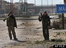 In this Tuesday Feb. 26, 2013 file photo, Free Syrian Army fighters patrol at the Aleppo-Damascus highway which is controlled by the rebels to cut supply for the Syrian army forces, at the front line of Maaret al-Numan town, in Idlib province, Syria. (AP Photo/Hussein Malla, File)