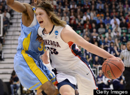 Kelly Olynyk #13 of the Gonzaga Bulldogs with the ball against Brandon Moore #32 of the Southern University Jaguars in the first half during the second round of the 2013 NCAA Men's Basketball Tournament at EnergySolutions Arena on March 21, 2013 in Salt Lake City, Utah. (Photo by Harry How/Getty Images)