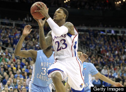 Ben McLemore #23 of the Kansas Jayhawks drives for a shot attempt in the first half against Reggie Bullock #35 of the North Carolina Tar Heels during the third round of the 2013 NCAA Men's Basketball Tournament at Sprint Center on March 24, 2013 in Kansas City, Missouri. (Photo by Ed Zurga/Getty Images)
