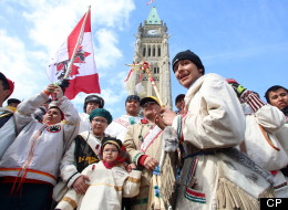 A group of young aboriginal people who travelled 1,600 kilometre on foot from the James Bay Cree community of Whapmagoostui, Quebec celebrate their arrival on Parliament hill in Ottawa, Monday, March 25, 2013. THE CANADIAN PRESS/ Fred Chartrand