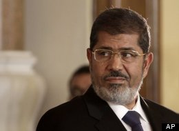 In this Friday, July 13, 2012 file photo, Egyptian President Mohammed Morsi holds a joint news conference with Tunisian President Moncef Marzouki, unseen, at the Presidential palace in Cairo, Egypt. (AP Photo/Maya Alleruzzo, File)