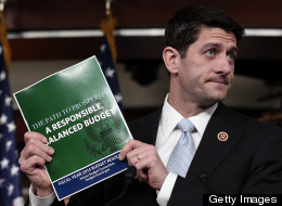 Rep. Paul Ryan (R-Wis.) holds up a copy of his budget at a March 12 press event, a plan that would decimate programs for the poor. (Win McNamee/Getty Images)