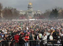 Marijuana smoke rises from a smoking crowd April 20, 2010 at a pro-pot '4/20' celebration in front of the state capitol building in Denver, Colorado. (Photo by John Moore/Getty Images)