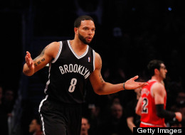 Deron Williams #8 of the Brooklyn Nets celebrates after hitting a basket during the game against the Chicago Bulls during Game One of the Eastern Conference Quarterfinals of the 2013 NBA Playoffs at Barclays Center on April 20, 2013 in New York City.