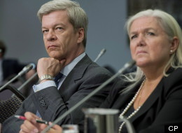 Luc Lavoie, Sun News network's head of development (left) and Julie Tremblay, Chief Operating Officer, Sun Media Corporation attend a CRTC mandatory distribution public hearing in Ottawa on Tuesday, April 23, 2013. (THE CANADIAN PRESS/Justin Tang)