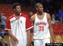 Jarron Collins #31 of the Stanford Cardinal looks on with Jason Collins #34 during the 2000 NCAA Tournament.