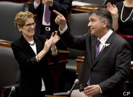 In a last-ditch bid to stay alive and avoid an election, Ontario's minority Liberals revealed a $127.6-billion budget Thursday awash in NDP orange along with the red ink. (CP)