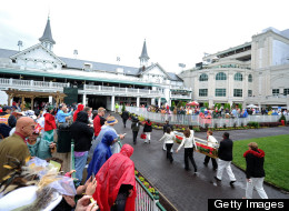 Roses are carried through the paddock during the 139th running of the Kentucky Derby at Churchill Downs on May 4, 2013 in Louisville, Kentucky.