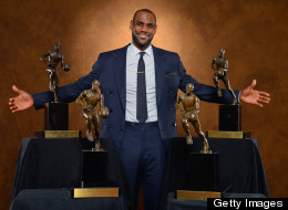 : LeBron James #6 of the Miami Heat poses with his collection of Maurice Podoloff Trophies after being named the 2012-2013 Kia NBA Most Valuable Player (MVP) of the Year for the fourth time on May 5, 2013 at American Airlines Arena in Miami, Florida.