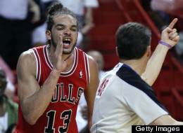 Joakim Noah curses at referee Scott Foster as he is ejected from the game in the fourth quarter against the Heat during the NBA Eastern Conference playoffs in Miami, Florida, Wednesday, May 6, 2013.