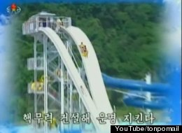 A still from North Korea's latest propaganda video shows people on a waterslide. The video also features images of tanks, missiles and exploding bombs. (credit: YouTube/tonpomail)