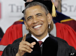 resident Barack Obama laughs at something on the video screen at Ohio Stadium before delivering the commencement speech for Ohio State University's spring commencement Sunday, May 5, 2013, in Columbus, Ohio. (AP Photo/Mark Duncan)
