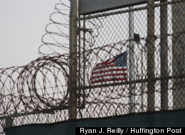 A flag flies over a prison camp at Naval Station Guantanamo Bay last month (Ryan J. Reilly / Huffington Post).
