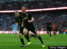 Ben Watson of Wigan Athletic celebrates scoring the only goal with team mate Callum McManaman (L) during the FA Cup Final against Manchester City at Wembley Stadium on May 11, 2013 in London, England.
