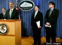 Acting commissioner of the IRS, Steven Miller (far right), shown during a news conference at the Department of Justice on Dec. 16, 2009, with Attorney General Eric Holder, expressed