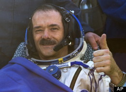 Canadian astronaut Chris Hadfield, who became a worldwide sensation thanks to his tweets, musical performances and stunning photos from the International Space Station, was back on the ground Monday night. (CP/AP)