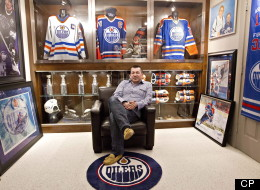Shawn Chaulk poses with his collection of Wayne Gretzky memorabilia in Fort McMurray, Alta., on Wednesday April 16, 2013. Chaulk will have a variety of these items for sale at an upcoming auction. Chaulk's Gretzky collection goes on sale in an online auction on Friday. THE CANADIAN PRESS/Jason Franson