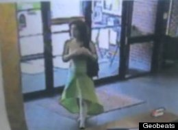 Investigators are looking for this woman who robbed a bank on Monday in Stuart, Iowa, in a stylish green dress.