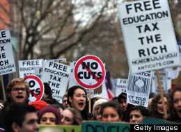 Demonstrators chant slogans during a student rally in central London on November 21, 2012 against sharp rises in university tuition fees, funding cuts and high youth unemployment. AFP PHOTO/CARL COURT (Photo credit should read CARL COURT/AFP/Getty Images)