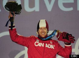 Jon Montgomery shows off his gold medal at the 2010 Vancouver Winter Games.