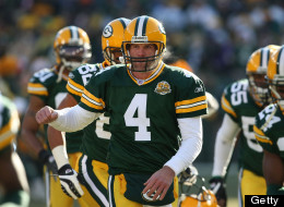 Brett Favre #4 of the Green Bay Packers runs onto the field with teammates during player introductions before a game against the Oakland Raiders on December 9, 2007 at Lambeau Field in Green Bay, Wisconsin. (Photo by Jonathan Daniel/Getty Images)
