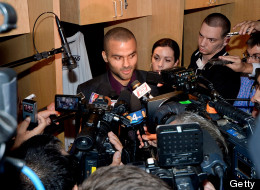 Tony Parker of the San Antonio Spurs speaks to members of the media in the locker room following his team's victory against the Miami Heat during Game Three of the 2013 NBA Finals on June 11, 2013 at AT&T Center in San Antonio, Texas.