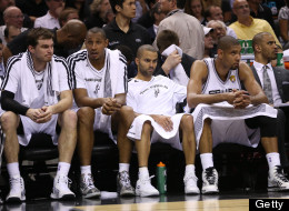 (L-R) Tiago Splitter #22, Boris Diaw #33, Tony Parker #9 and Tim Duncan #21 of the San Antonio Spurs sit on the bench late in the fourth quarter while taking on the Miami Heat during Game Four of the 2013 NBA Finals at the AT&T Center on June 13, 2013 in San Antonio, Texas.