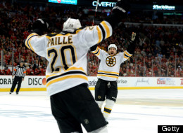 (L-R) Daniel Paille #20 and Andrew Ference #21 of the Boston Bruins celebrate after Paille scored the game-winning goal in the first overtime against the Boston Bruins in Game Two of the NHL 2013 Stanley Cup Final at United Center on June 15, 2013 in Chicago, Illinois.