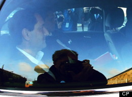 Montreal Mayor Michael Applebaum is taken away by police after being arrested at his home in Montreal on Monday, June 17, 2013. THE CANADIAN PRESS/Mario Beauregard