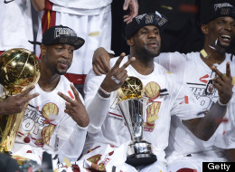 Dwyane Wade (L), LeBron James (C) and Chris Bosh (R) of the Miami Heat celebrate winning Game 7 of the NBA Finals at the American Airlines Arena June 20, 2013 in Miami, Florida.