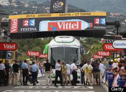 The Orica-Greenedge team bus collides with the finishing banner prior to the race arriving at the end of stage one of the 2013 Tour de France, a 213KM road stage from Porto-Vecchio to Bastia, on June 29, 2013 in Bastia, France. (Photo by Doug Pensinger/Getty Images)
