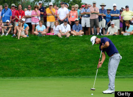 Adam Scott putts the ball at the seventh hole during AT&T National on June 27, 2013.