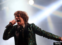 GLASTONBURY, ENGLAND - JUNE 29:  Mick Jagger of The Rolling Stones performs on the Pyramid Stage at the Glastonbury Festival of Contemporary Performing Arts site at Worthy Farm, Pilton on June 29, 2013 near Glastonbury, England. The wholesale market caters for traders throughout the Festival who are estimated to provide 3 million meals for festival goers, crew and performers. Gates opened on Wednesday at the Somerset diary farm that will be playing host to one of the largest music festivals in t