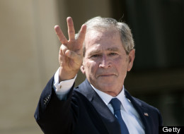 Former US President George W. Bush makes a 'W' with his fingers during a dedication ceremony at the George W. Bush Library and Museum. (Photo credit should read BRENDAN SMIALOWSKI/AFP/Getty Images)