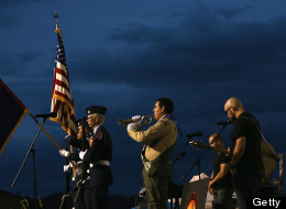 PRESCOTT, AZ - JULY 02:  A member of the Boy Scouts of America plays a bugle tribute as the colors are posted at a candlelight vigil in honor of the 19 fallen firefighters at Prescott High School on July 2, 2013 in Prescott, Arizona. 19 Granite Mountain Interagency Hotshot Crew firefighters died battling a fast-moving wildfire near Yarnell, AZ on Sunday.  (Photo by Christian Petersen/Getty Images)