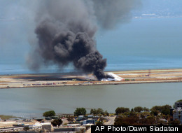 This photo provided by Dawn Siadatan shows Asiana Airlines flight 214 just moments after crashing at the San Francisco International Airport in San Francisco, Saturday, July 6, 2013. (AP Photo/Dawn Siadatan)