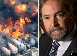 """NDP Leader Thomas Mulcair has been accused of sinking to a """"new low"""" for slamming the Conservative government after the deadly weekend rail disaster in Lac-Megantic. (CP)"""