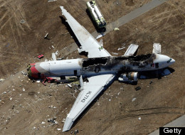 SAN FRANCISCO, CA - JULY 06:  A Boeing 777 airplane lies burned on the runway after it crash landed at San Francisco International Airport July 6, 2013 in San Francisco, California. An Asiana Airlines passenger aircraft coming from Seoul, South Korea crashed while landing. (Photo by Ezra Shaw/Getty Images)