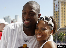 MIAMI - JUNE 23:  Dwyane Wade of the Miami Heat poses for a photo with then-wife Siohvaughn, during the Heats NBA championship victory parade at American Airlines Arena on June 23, 2006 in Miami, Florida.