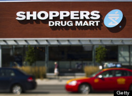 A Shoppers Drug Mart Corp. store stands in this photo taken with a tilt-shift lens in Toronto, Ontario, Canada, on Saturday, Aug. 27, 2011. Shoppers Drug Mart Corp. is Canada's largest pharmacy chain with more than 1,149 stores operating in nine provinces and two territories. Photographer: Brent Lewin/Bloomberg via Getty Images