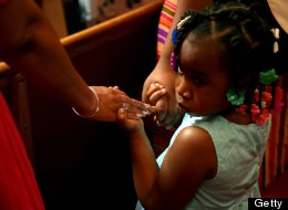 Parishioners at Trinity United Church of Christ hold hands during prayer service in Chicago, Illinois, Sunday July 14, 2013 in solidarity with the family of Trayvon Martin. (Nancy Stone/Chicago Tribune/MCT via Getty Images)