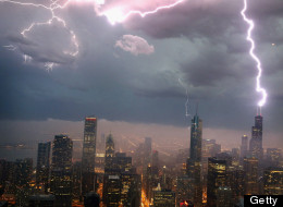 CHICAGO, IL - JUNE 12:  Lightning strikes the Willis Tower (formerly Sears Tower) in downtown on June 12, 2013 in Chicago, Illinois. A massive storm system with heavy rain, high winds, hail and possible tornadoes is expected to move into Illinois and much of the central part of the Midwest today.  (Photo by Scott Olson/Getty Images)