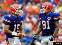 Tim Tebow #15 of the Florida Gators speaks with Aaron Hernandez #81 during the game against the Troy Trojans at Ben Hill Griffin Stadium on September 12, 2009 in Gainesville, Florida.  (Photo by Sam Greenwood/Getty Images)
