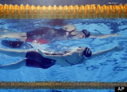 Missy Franklin of the United States swims to the gold medal in the Women's 100m backstroke final at the FINA Swimming World Championships in Barcelona, Spain, Tuesday, July 30, 2013.