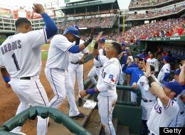 The Texas Rangers' Nelson Cruz is greeted at the dugout steps after his second-inning home run against the Los Angeles Angels at the Rangers Ballpark in Arlington on Wednesday July 31, 2013, in Arlington, Texas. (Ron T. Ennis/Fort Worth Star-Telegram/MCT via Getty Images)