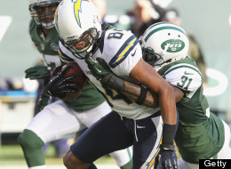 Danario Alexander of the San Diego Chargersis facemasked by Cornerback Antonio Cromartie #31 the New York Jets. (Photo by Al Pereira/New York Jets/Getty Images)